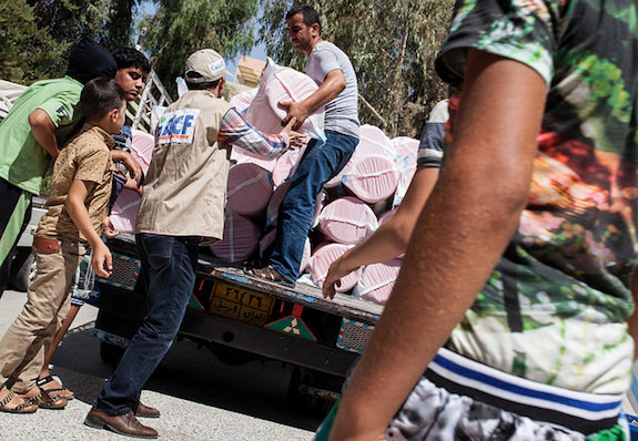 Action against hunger team deliver hygiene kits to iraqi refugees.by dfid