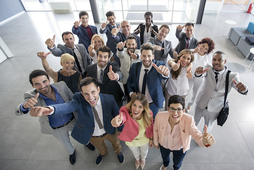 Portrait of smiling group of diverse people giving thumps up istock copy
