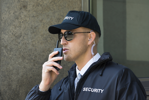 Security guard using walkie talkie radio.istock small